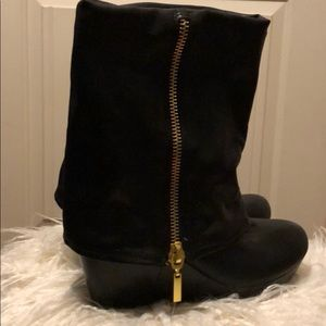 Black wedge heel boots with Gold faux zippers.